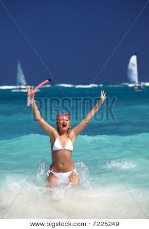 Smiling Woman Holding Snorkel Gear