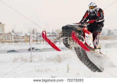 Sportsman on snowmobile on track