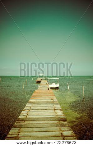 wooden pier dock jetty relaxing ocean view caye caulker belize caribbean poster
