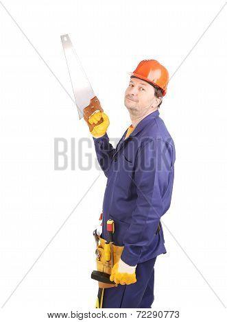 Worker in hard hat holdind handsaw.