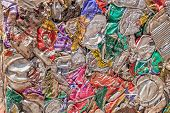 Crushed aluminium cans are reduced to square blocks when recycled at a scrap yard. poster