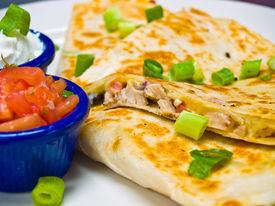 Chicken Quesadilla With Sour Cream And Salsa