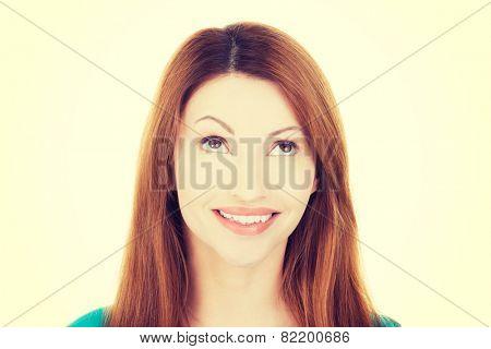 Beautiful caucasain woman looking up.