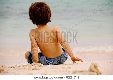 boy looking at the sea