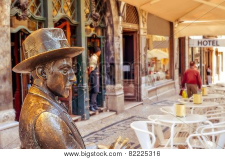 LISBON, PORTUGAL - MARCH 18: Statue of Fernando Pessoa outside of Cafe A Brasileira on March 18, 2014 in Lisbon, Portugal. This iconic statue and the cafe itself are visited by thousands of tourists