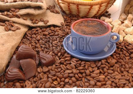 Coffee Beans, chocolate And Cup