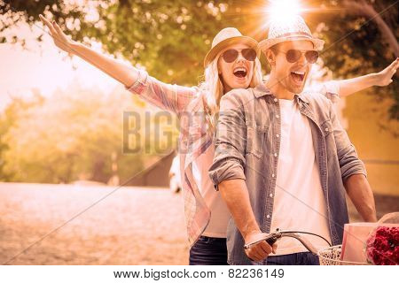 Hip young couple going for a bike ride on a sunny day in the city