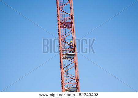 Worker Climbs A Tall Crane
