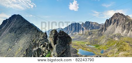Clastic Rock And A View Of The Mountain Valley. Eastern Siberia