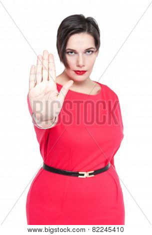 Beautiful Plus Size Woman Making Stop Sign Gesture Isolated. Focus On Hand