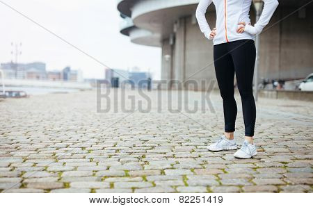 Fitness Female Standing On Sidewalk In City