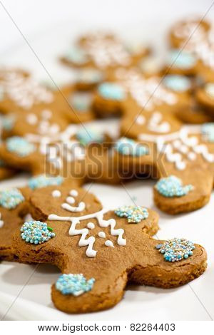 closeup of fresh baked gingerbread men cookies with decorations