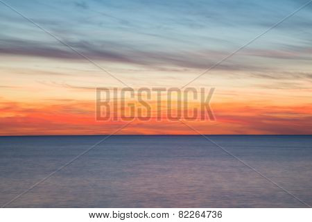 Ocean, blurry movement background at sunset