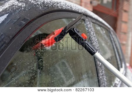 Clearing Of A Sleet At A Car Window With Use Of A Brush
