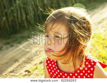 Cute Little Kid Is Crying Outdoors