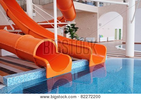 Orange waterslide, indoor pool