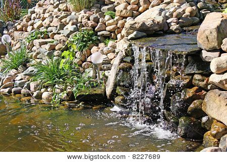 Waterfall into a pond