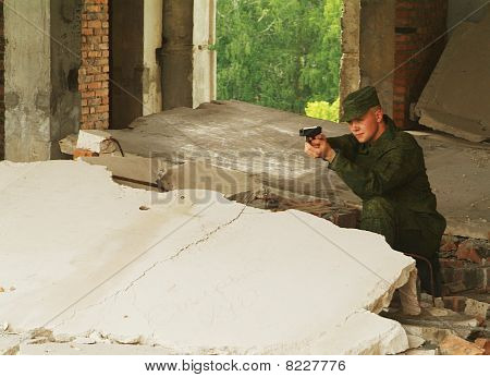 The Soldier With A Pistol Performs Antiterrorist Operation.