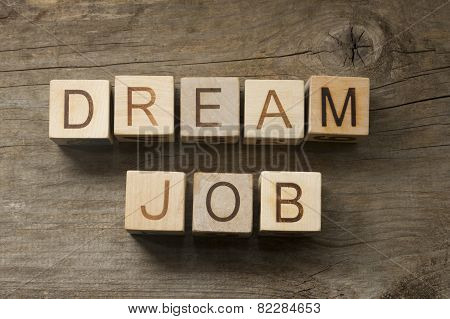 Dream Job text on a wooden background