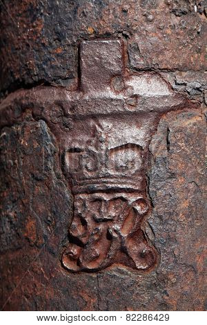 Crown And Royal Cypher On Old Cannon In The Caribbean