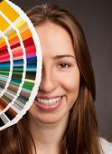 young woman holding a pantone palette poster