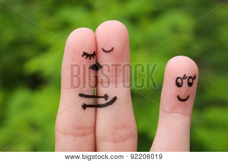 Finger art of a Happy couple. The happy couple kissing and hugging. The other girl looks at them and