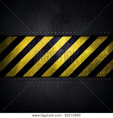 Detailed abstract metallic background with scratches and stains and yellow and black warning stripes
