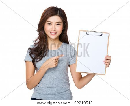 Asian woman with finger point to clipboard