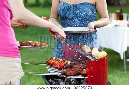 Host serving grilled meals on barbecue party poster