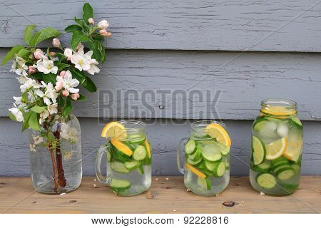 Flavored Cucumber Water Served In Glass Jars