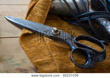 old tailor scissors in the shop floor of a upholstery manufactory narrow depth of field poster