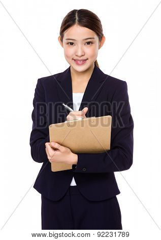 Young businesswoman jot down some on clipboard