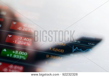 Stock market graph with a shadow of pen