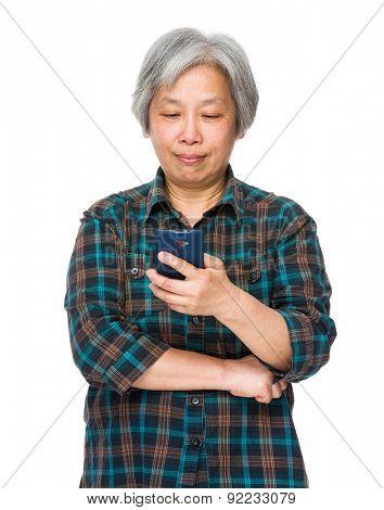 Elderly woman read on cellphone