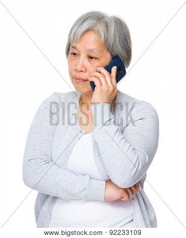 Mature woman talk to smart phone
