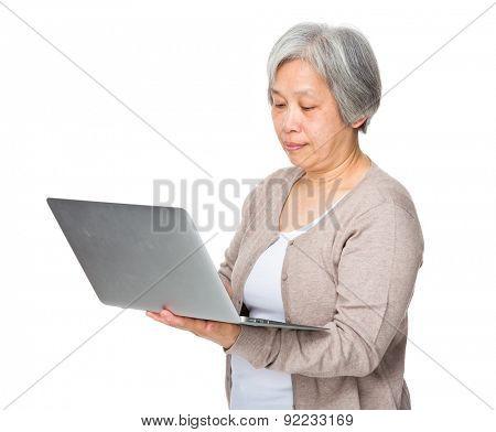 Elderly woman use of laptop computer