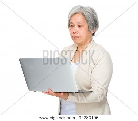 Old woman use of laptop computer