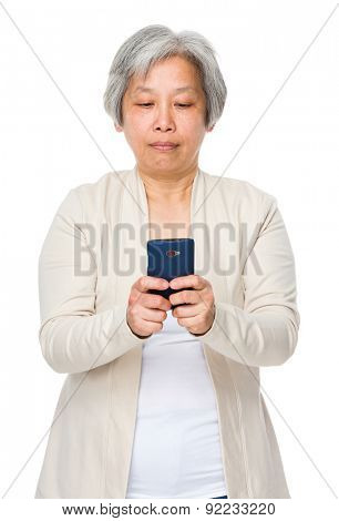 Asian mature woman use of cellphone
