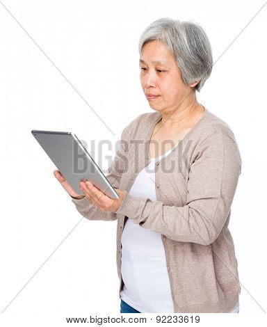 Elderly woman use of tablet