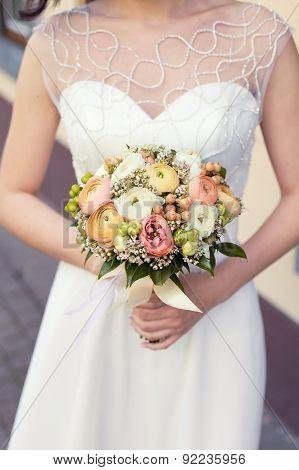 Beautiful wedding colorful nosegay of ranunculus