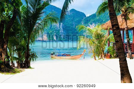 Coast of island with long tail boat, Thailand