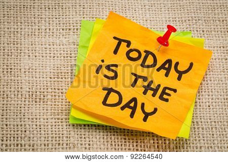 today is the day reminder on a sticky note against burlap canvas