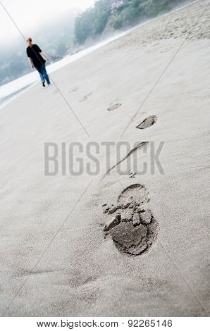 Footprints On Sand And Person