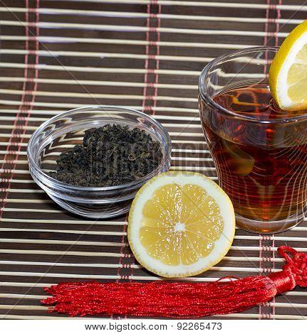Tea With Part Of A Lemon Near A Glass With Tea, A Subject Drinks
