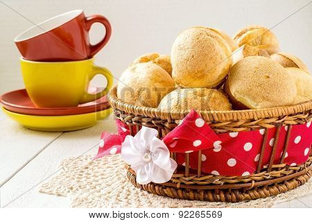 Freshly Baked Homemade Popover In The Basket And Cups Of Tea