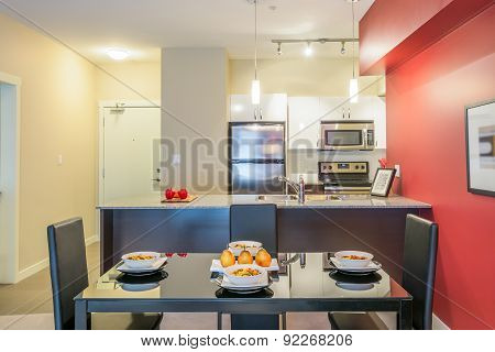 Modern red dining room with kitchen in a luxury apartment. Interior design.