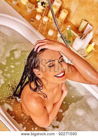 Young woman washing hair and take bubble  bath.