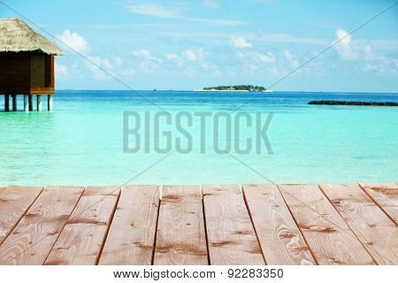 View of beautiful blue ocean water and bungalows in Baros Maldives poster