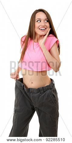 Young slim woman wearing too big pats isolated on white poster
