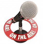 On the Air words in a ring around a microphone to illustrate a live report or interview on radio or podcast program poster